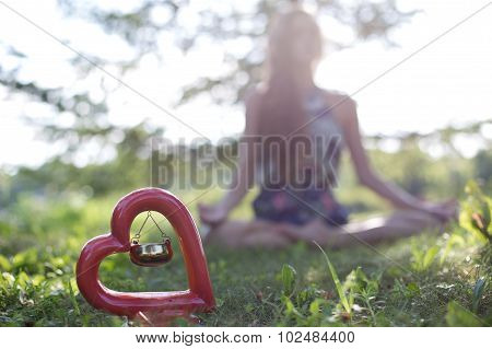 Beautiful oil burner with a girl meditating on the background