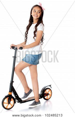 girl riding a scooter