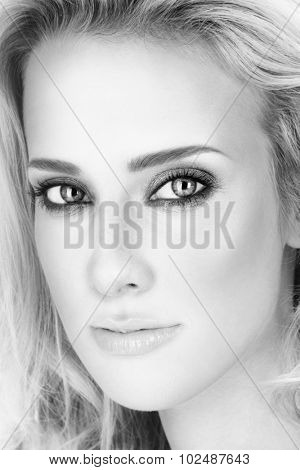 Black and white close-up portrait of young beautiful woman with smoky eyes