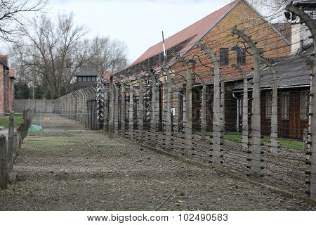 OSWIECIM, POLAND - APRIL 16 2015: Electric fence in former German concentration camp Auschwitz I Poland