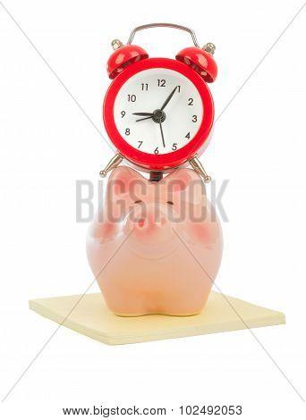 Alarm clock on piggy bank