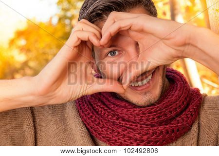 happy man portrait making heart concept sign