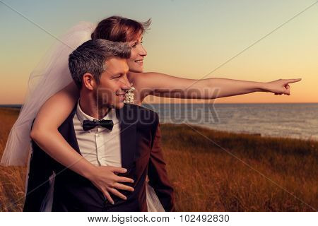 wedding couple outstretched finger showing destination