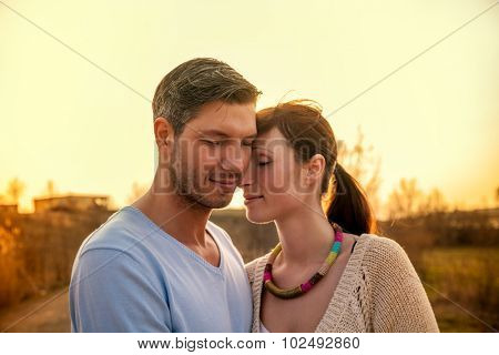 sensual sensitive romantic couple on lake