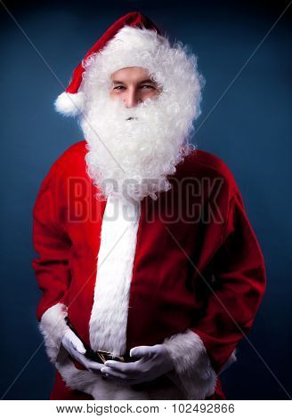 santa blue clause portrait holding tummy