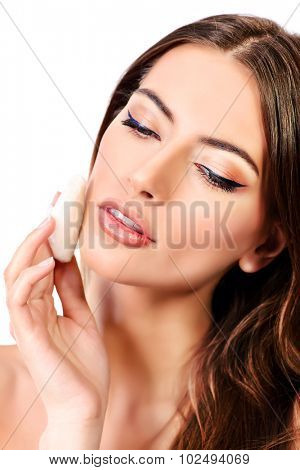 Beautiful young woman with pure fresh skin. Youth and beauty. Skincare, Spa. Isolated over white.