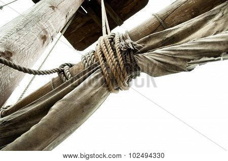 Mast Of Pirate Ship With Old Sails Tied Rope Isolated