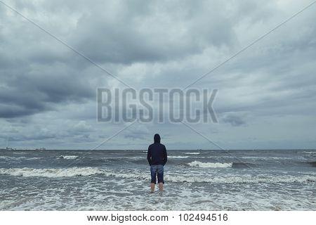 alone man on the beach