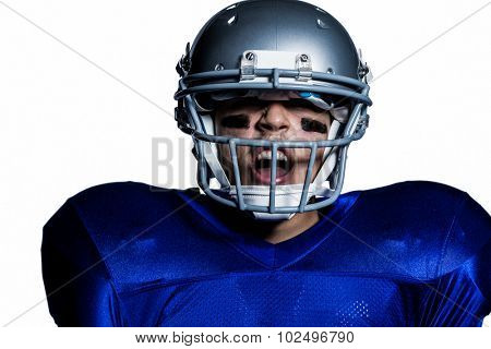 Aggressive American football player against white background