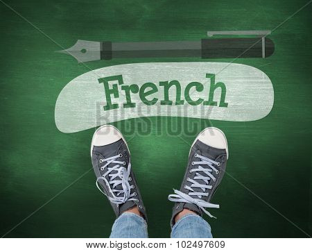 The word french and casual shoes against green chalkboard