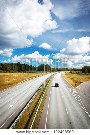 Motorway in summer with beautiful clouds