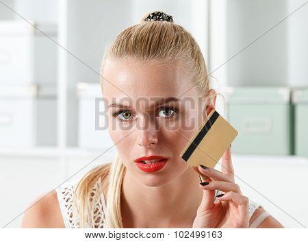 Beautiful Blonde Woman Holding Golden Credit Card