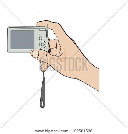 Man holding digital camera.