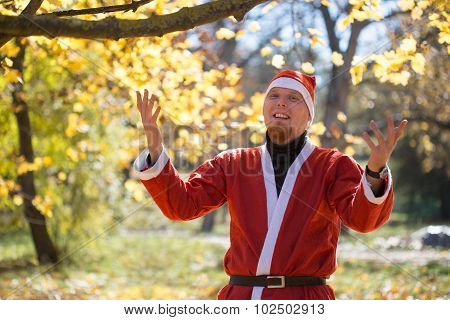 Santa Claus In Autumnal Park