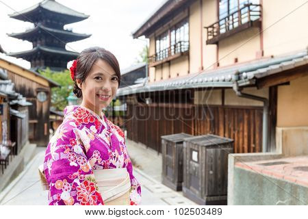 Woman with kimono dress in yasaka pagoda