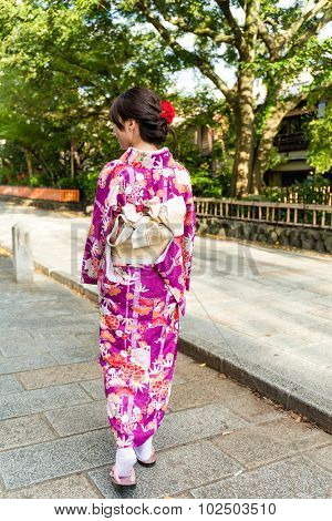 Woman with kimono dress and walking on the street in Gion Kyoto