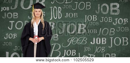 Blonde student in graduate robe against green chalkboard