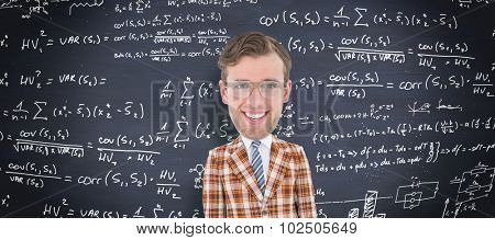Geeky businessman against blackboard