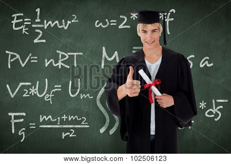 Happy Teen Guy Celebrating Graduation against green chalkboard