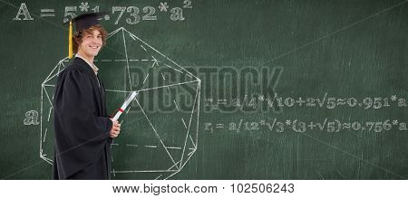 Profile view of a student in graduate robe against green chalkboard