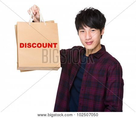 Asian Man hold with shopping bag and showing a word discount
