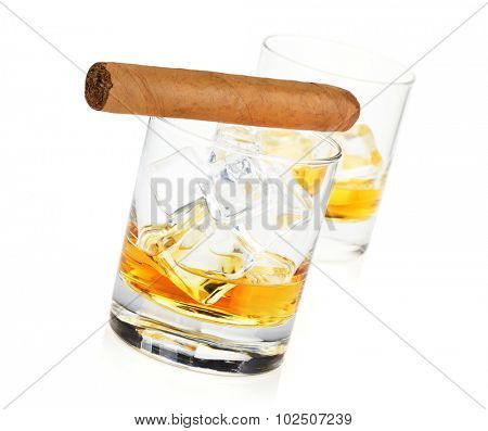 Two whiskey glasses and cigar. Isolated on white background
