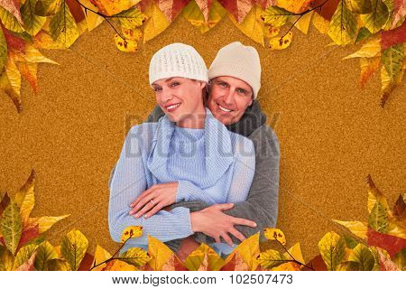 Casual couple in warm clothing against autumn leaves pattern