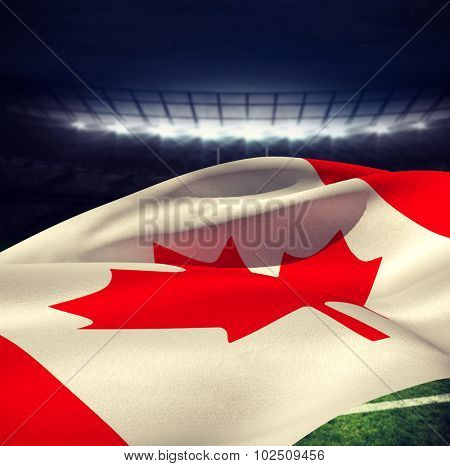 Low angle view of Canadian flag against rugby stadium