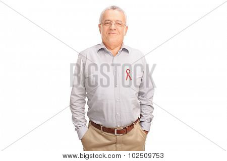 Cheerful senior gentleman posing with an AIDS badge on his shirt isolated on white background