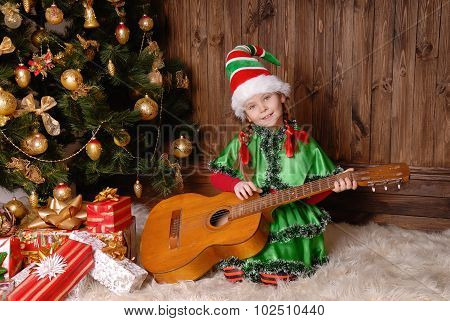 Girl - the Christmas elf with a guitar