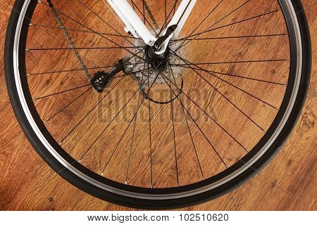 Rear bicycle wheel on the wooden floor