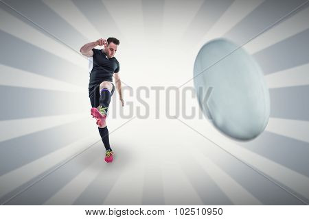 Rugby player kicking against linear design