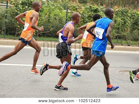Marathon runners running on city road