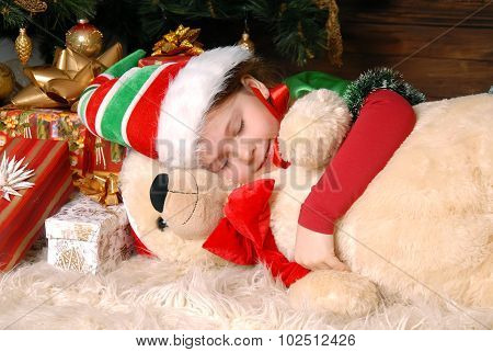 Girl - The Christmas Elf Sleeps Under A Fir-tree