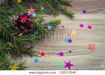 Spruce Branches With Festive Decoration On The Wooden Background