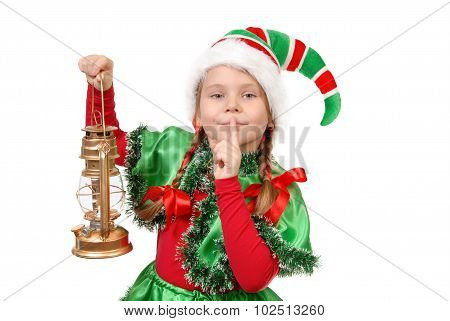 Girl in suit of Christmas elf with oil lamp