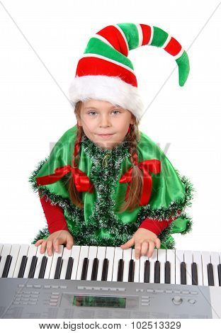 Girl - Santa's elf plays a synthesizer.