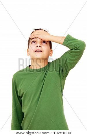 Teenage Boy With Arm On Forehead