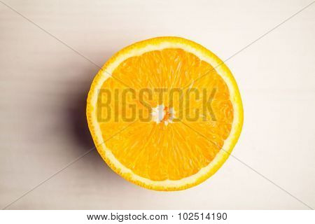 Overhead view of halved orange on the table
