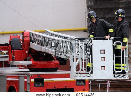 Firefighters In The Fire Truck Basket During The Practice Of Training
