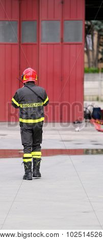 Firefighters In Uniform In The Firehouse