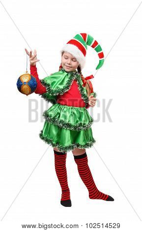 Santa's elf with a Christmas ball. Isolated on a white