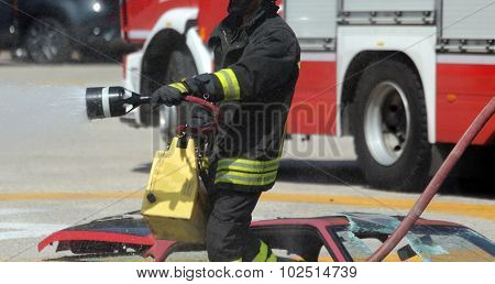 Firefighters With The Fire Extinguisher During A Practice Session At Fire Station
