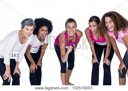 Portrait of happy athletes bending while standing against white background