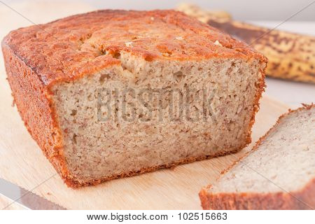 close up of banana bread on wooden chopping board