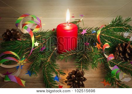 Candle In A Spruce Branch And Festive Decoration