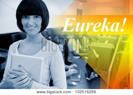 The word eureka! against teacher with tablet pc