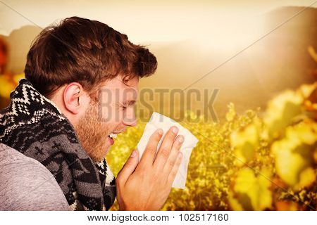Close up side view of man blowing nose against greenness field of grapevine