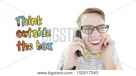 Geeky hipster holding a retro cellphone against think outside the box
