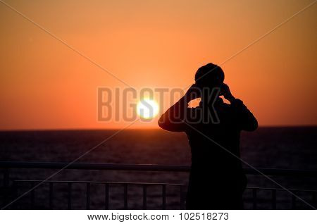 Man Take Picture Of Sunset